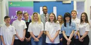14-16 Academy students celebrate their outstanding achievement with Tutor Kirk-Newton Henry